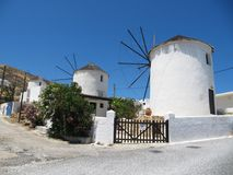Traditional windmill in Chora. Three traditional windmill in historic city of Chora at the beginning of summer season, Serifos island, Cyclades archipelago Stock Photo