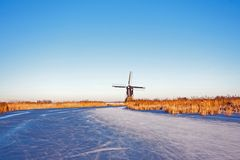Traditional windmill in the countryside from the Netherlands. In winter Stock Photos