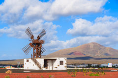 Traditional windmill in desert landscape of Lanzarote Stock Photo