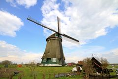 Traditional windmill in dutch landscape Stock Images