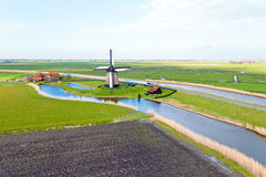 Traditional windmill in a dutch landscape in Netherlands Royalty Free Stock Images