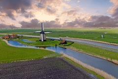 Traditional windmill in a dutch landscape in Netherlands Royalty Free Stock Image