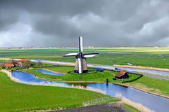 Traditional windmill in a dutch landscape in the Netherlands Stock Images
