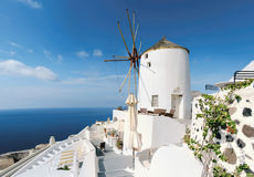 Traditional windmill of Oia, Santorini. On a sunny day, panoramic image Royalty Free Stock Photo