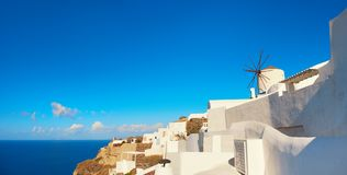 Traditional windmill in Oia village, Santorini, Greece, text sp Stock Photos