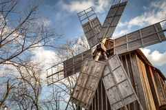 Traditional windmill in a romanian village Royalty Free Stock Photo