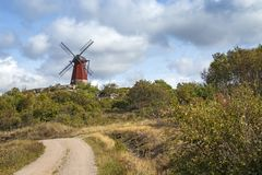 Traditional windmill, Sweden. This traditional windmill stands near the Swedish skerry archipelago in the province of Bohuslan stock photography