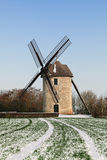 Traditional windmill in winter. Traditional French windmill during the winter season Royalty Free Stock Photo