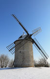 Traditional windmill in winter. Traditional French windmill during the winter season Royalty Free Stock Image