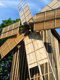 Traditional windmill. A traditional wooden windmill, on a sunny day Royalty Free Stock Image
