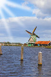 Traditional windmills and berthing bumpers. On coast of the channel in Holland Stock Photo