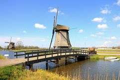 Traditional windmills in dutch landscape Royalty Free Stock Image