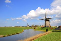 Traditional windmills in dutch landscape Stock Photos