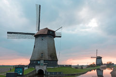 Traditional windmills in a dutch landscape in Netherlands Royalty Free Stock Images