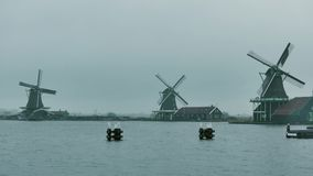 Traditional windmills in Netherlands on a rainy day royalty free stock photography