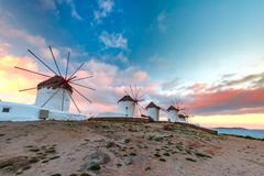 Traditional windmills at sunrise, Mykonos, Greece royalty free stock image