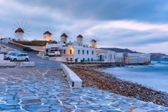 Traditional windmills at sunrise in Mykonos, Greece royalty free stock image