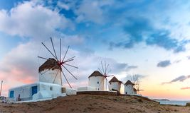 Traditional windmills at sunrise, Santorini, Greece Royalty Free Stock Images