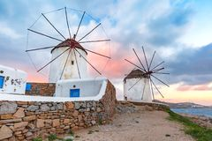 Traditional windmills at sunrise, Santorini, Greece Royalty Free Stock Photography