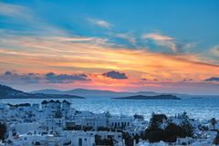 Traditional windmills at sunset, Santorini, Greece stock images