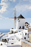 Traditional windmills in village Oia Santorini Stock Image