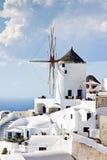 Traditional windmills in village Oia Santorini Stock Image