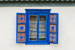 Traditional window with blue open shutters. Blue painted traditional window with blue open shutters in Tulcea, Romania Stock Photography
