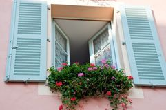 Traditional window with flowers Royalty Free Stock Photos