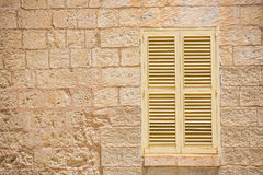 Traditional window in Mdina. Traditional window with shutter in Maltese Mdina Royalty Free Stock Image