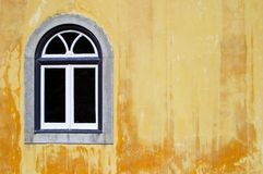 Traditional window on yellow background Royalty Free Stock Photos