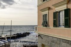 Traditional windows near rhe sea , Quinto,  Genova, Italy Royalty Free Stock Image