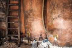 Traditional wine cellar with barrels in disrepair.  Royalty Free Stock Images