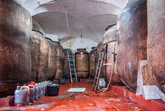 Traditional wine cellar with barrels in disrepair.  Stock Photography