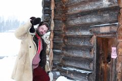 Traditional winter costume of peasant medieval age in russia. Beard man in traditional winter costume of peasant medieval age in russia stock photography