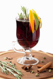 Traditional winter hot alcohol drinks mulled wine with orange, s Stock Photography