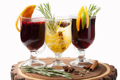 Traditional winter hot alcohol drinks mulled wine with orange, s Royalty Free Stock Photos