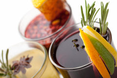 Traditional winter hot alcohol drinks mulled wine with orange, s Royalty Free Stock Images