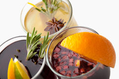 Traditional winter hot alcohol drinks mulled wine with orange, s Royalty Free Stock Photography