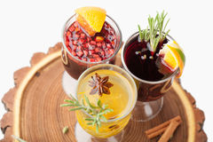 Traditional winter hot alcohol drinks mulled wine with orange, s Stock Photos