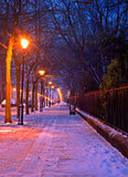 traditional winter snow scene at nightime Royalty Free Stock Image