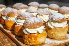 Traditional winter Scandinavian sweet: Semla or semlor, flavored with cardamom, filled with almond paste & whipped cream stock photos