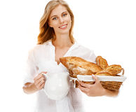 Traditional woman with bread and white carafe Royalty Free Stock Image