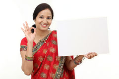 Traditional woman holding a blank billboard Stock Photos