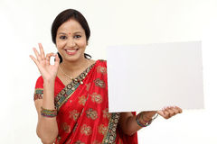 Traditional woman holding a blank billboard royalty free stock photo