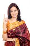 Traditional  woman holding her index finger up Royalty Free Stock Photo