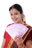 Traditional woman holding new 2000 rupee notes Royalty Free Stock Images