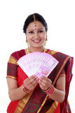Traditional woman holding new 2000 rupee notes Stock Image