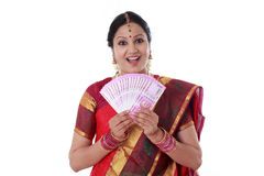 Traditional woman holding new 2000 rupee notes Royalty Free Stock Image