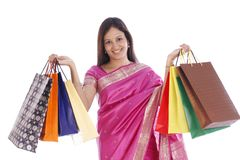 Traditional woman holding shopping bags Stock Photos