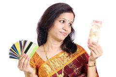 Traditional woman with Indian currency and credit cards Royalty Free Stock Photography